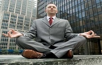 Meditating outside office building