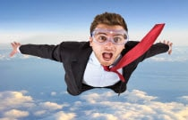 Businessman jumping out of airplane